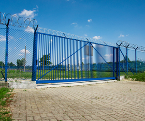 Security fence with sliding gate
