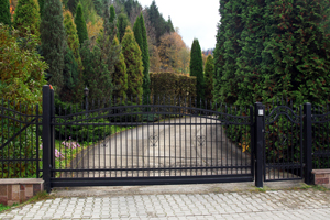 Swinging gate installed at driveway entrance